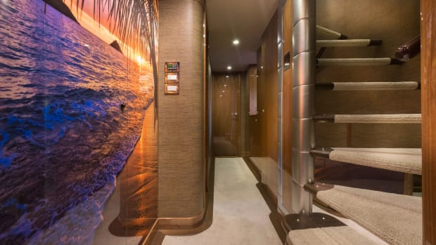A custom-made piece of art adorning the belowdeck foyer wall is reminiscient of a place where the owner loves to cruise.
