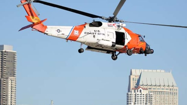 A Coast Guard MH60 Jayhawk helicopter hovers at Air Station San Diego.