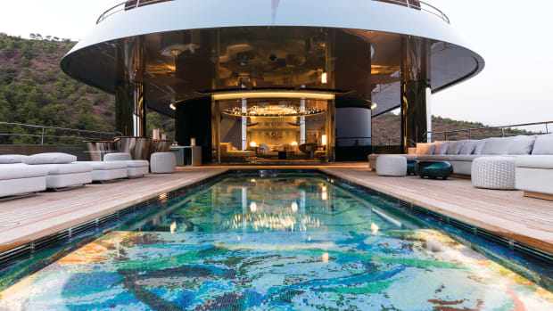 The 30-foot-long main-deck swimming pool is custom tiled in a variety of blues and greens, forming an eye-catching abstract work of art. This pool deck is flush to the main salon, enhancing the flow between inside and out.