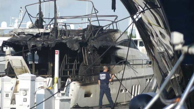 (Joe Cavaretta / Sun Sentinel)  Severely damaged yacht at Bahia Mar as seen on Thursday, Aprl 23, 2015, the morning after fire broke out.