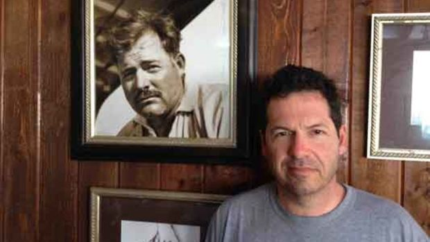 John Hemingway with a photo of his grandfather Ernest