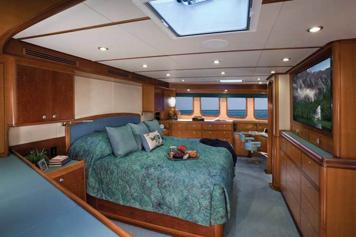 Large windows and an overhead hatch illuminate the master stateroom, which is forward on the main deck.