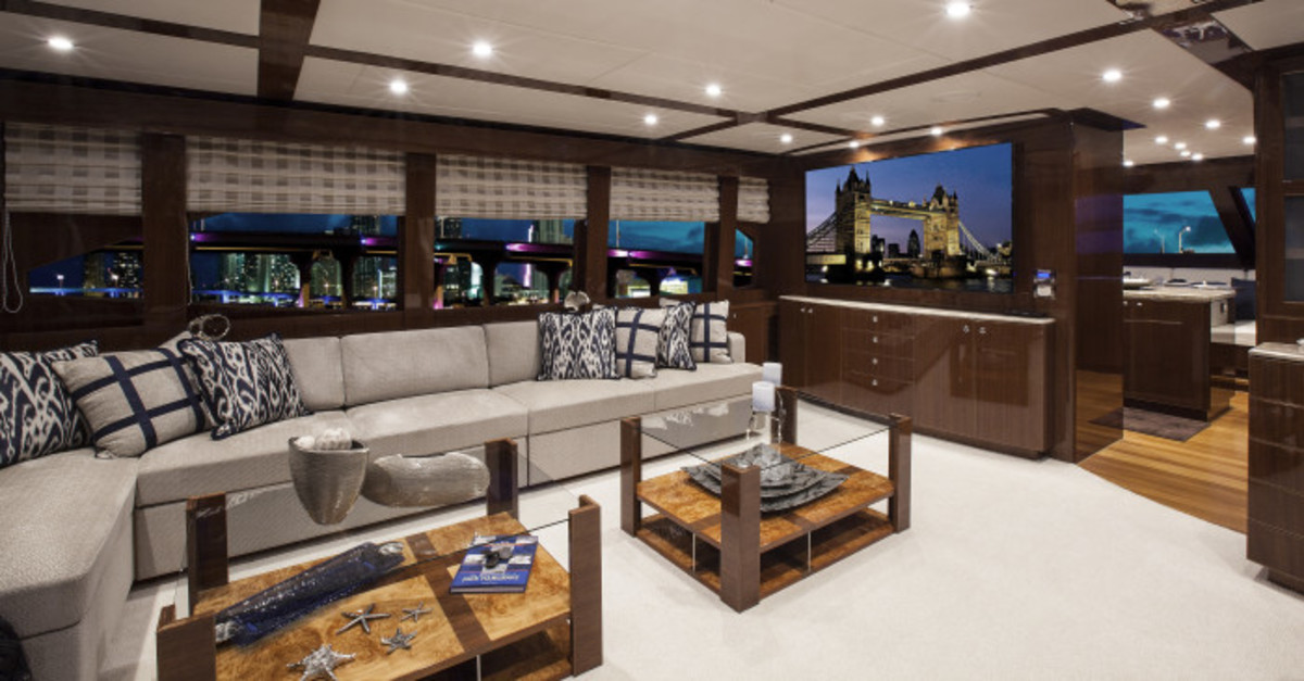 Big windows and custom-made, apartment-style furniture give this liveaboard motoryacht the feel of an upscale home.