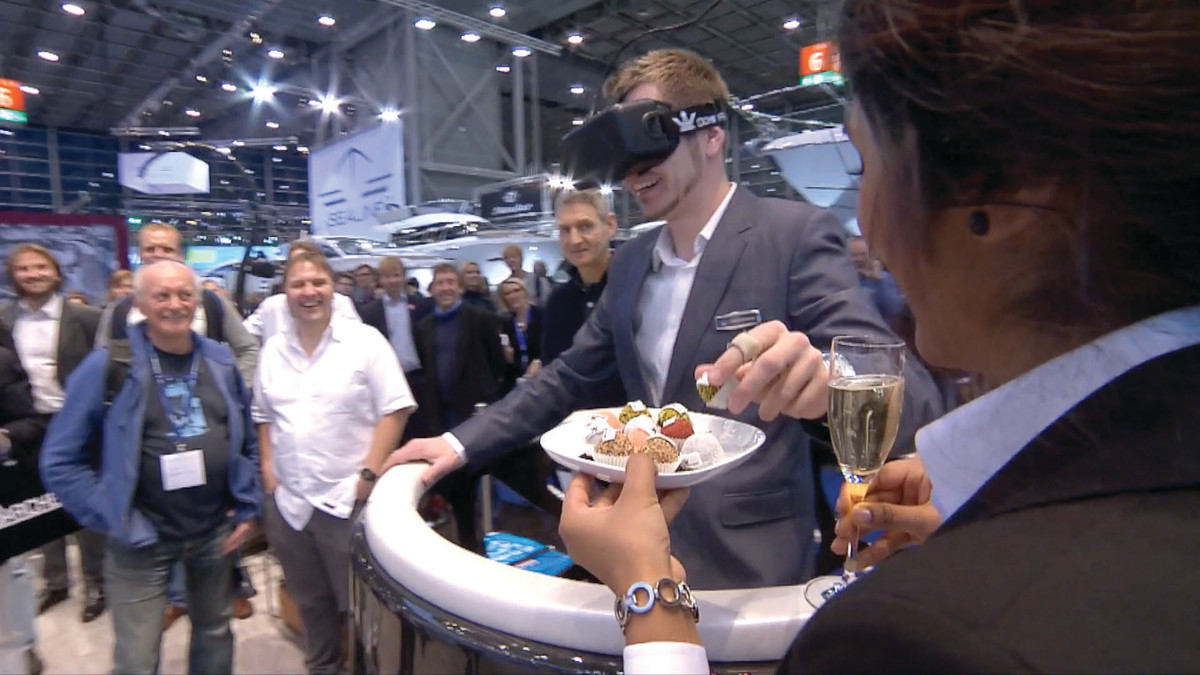 When virtual-reality users at the Dominator boat-show booth reach out for what they perceive as Champagne and hors d'oeuvres, a staffer makes the experience seem real.