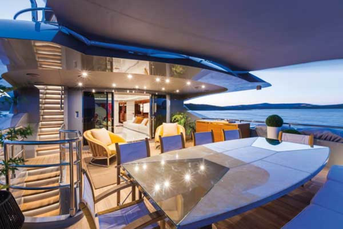 The onyx and stainless steel dining table on the upper afterdeck of Nameless is a custom design by Luca Dini