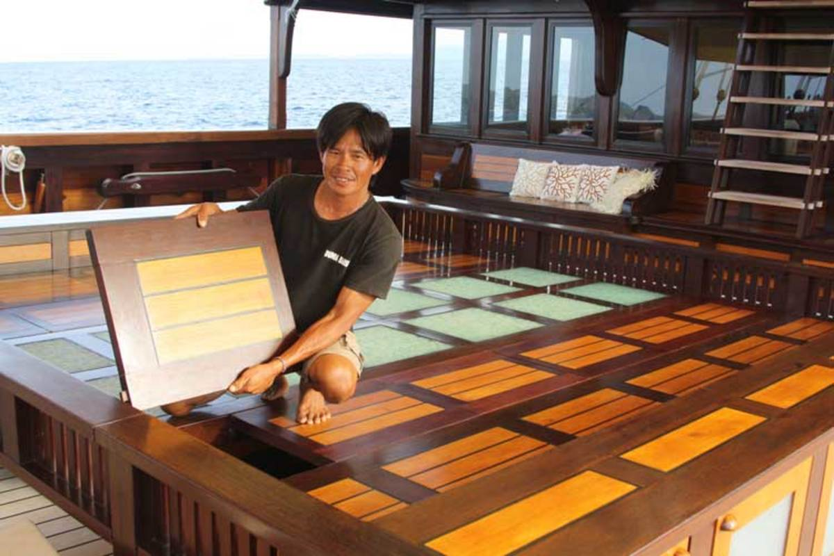 Crewmember Arman with the convertible seating and dining area he built.