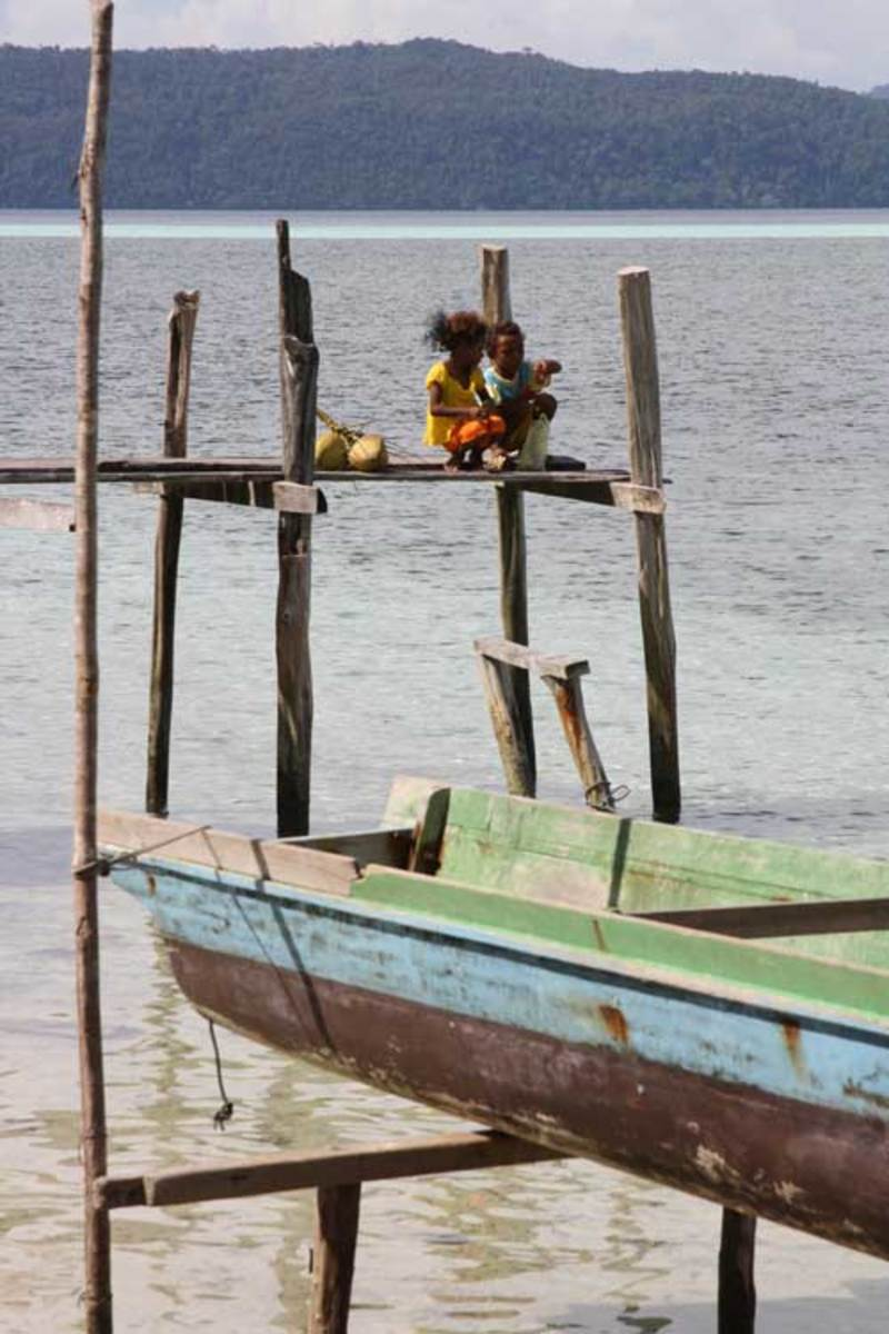Boats and the sea are a daily playground for island children.