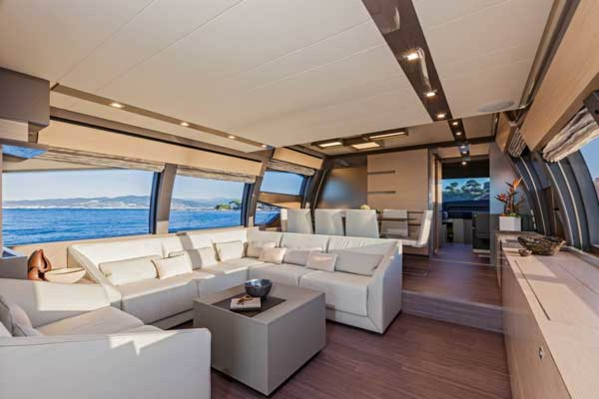 Looking forward along the Ferretti 750's main deck, past the enclosed galley, to the wheelhouse