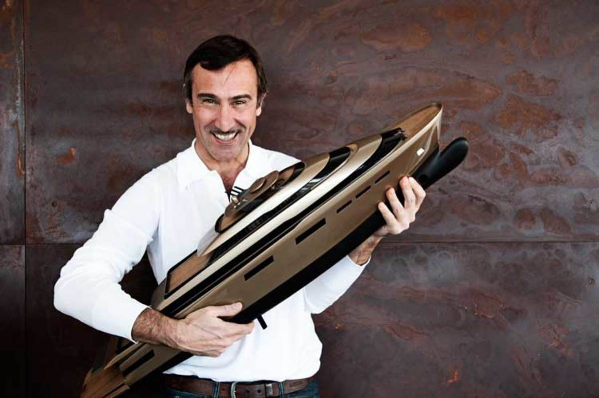 Stefano Pastrovich holding a model of 99-meter (325-foot) X-Vintage, a concept developed in conjunction with Fincantieri and Wärtsilä.