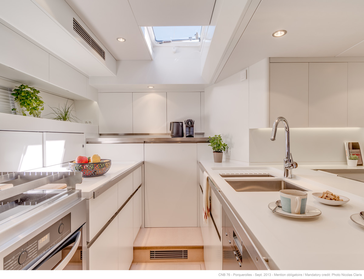 The galley is bright and airy, perfect for enjoying a cup of coffee or quick meal underway.