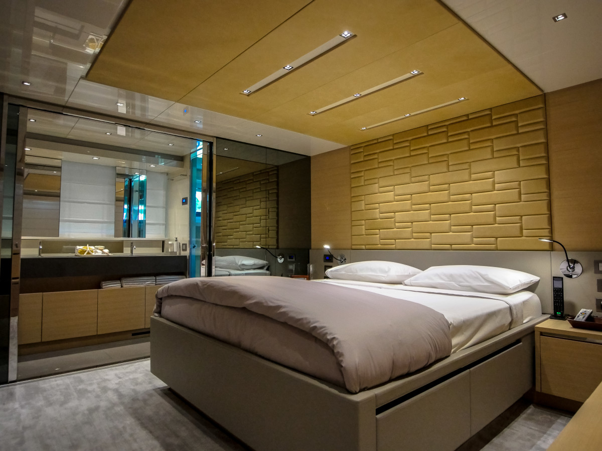 The full-beam master suite aft has stainless-framed windows, a bureau and a headboard made of leather bricks.