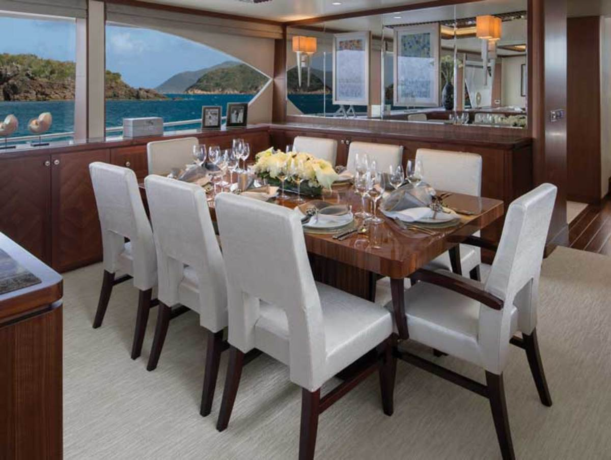 Cabinetry surrounding the formal dining area provides enough stowage for long-rage cruising or charter.