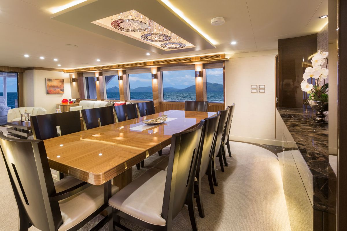 The formal dining area seats ten guests, typically a component of a vessel well into the 110- to 120-foot range.