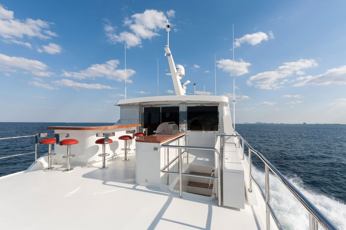 The bridge deck aft is equipped with a wet bar and grill.