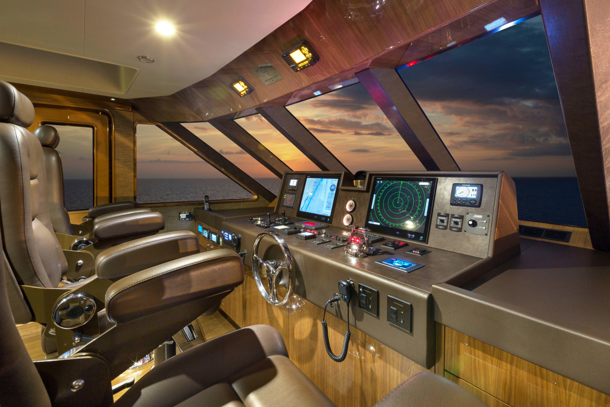 The pilothouse is all business, with three Stidd helm chairs and easy access to the Portuguese bridge.
