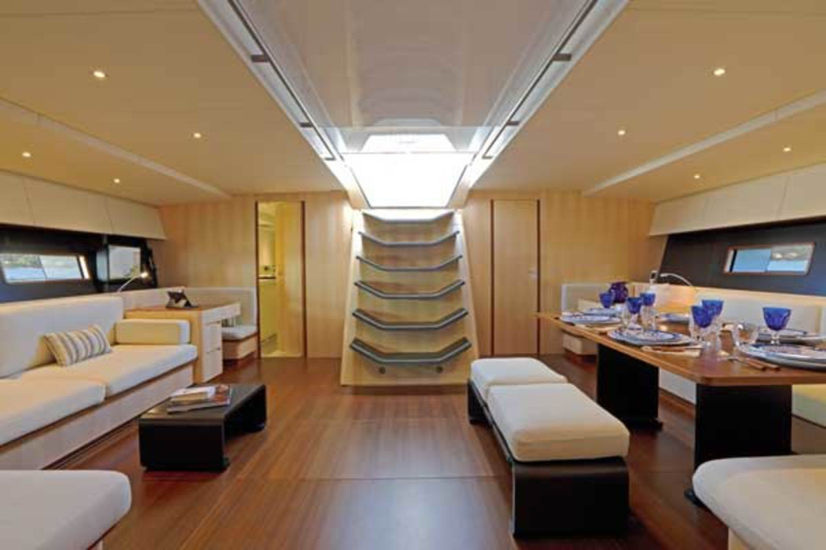 Magic Carpet3 may be fast and lightweight, but that does not mean creature comforts are swept away. Belowdecks, the sofa on the starboard side has all the comforts of home.