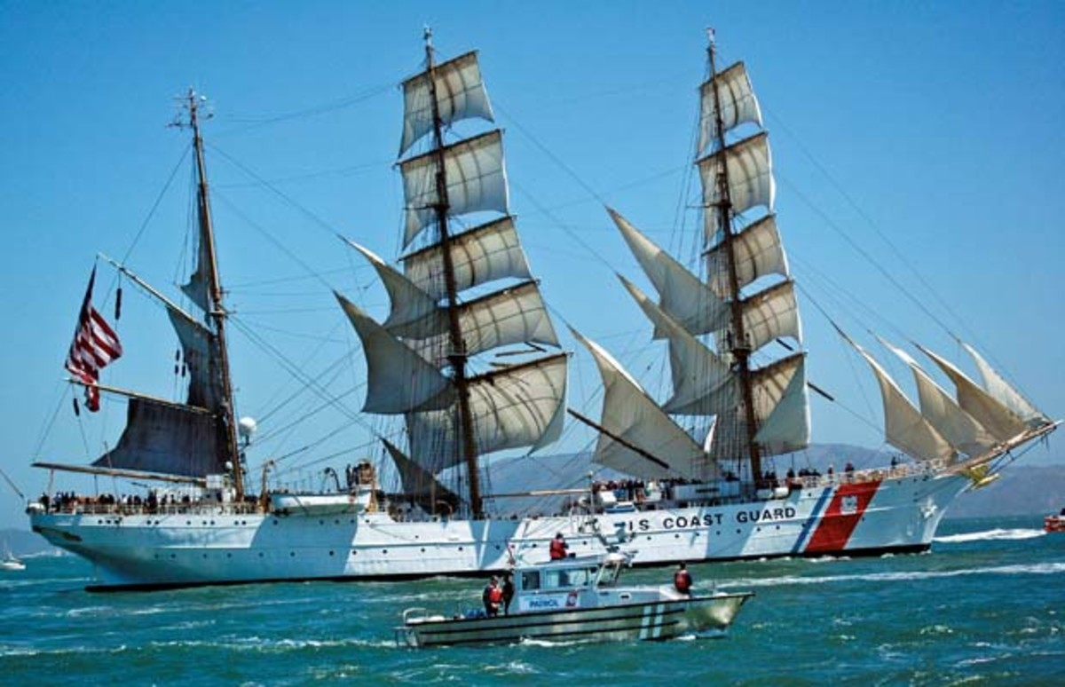Coast Guard auxiliary vessel Silver Charm escorts Coast Guard cutter Eagle, a three-masted sailing barque with 21,350 square feet of sail, during the Festival of Sail parade in San Francisco Bay. Commissioned in 1946, Eagle is the oldest ship of the U.S. Coast Guard fleet.