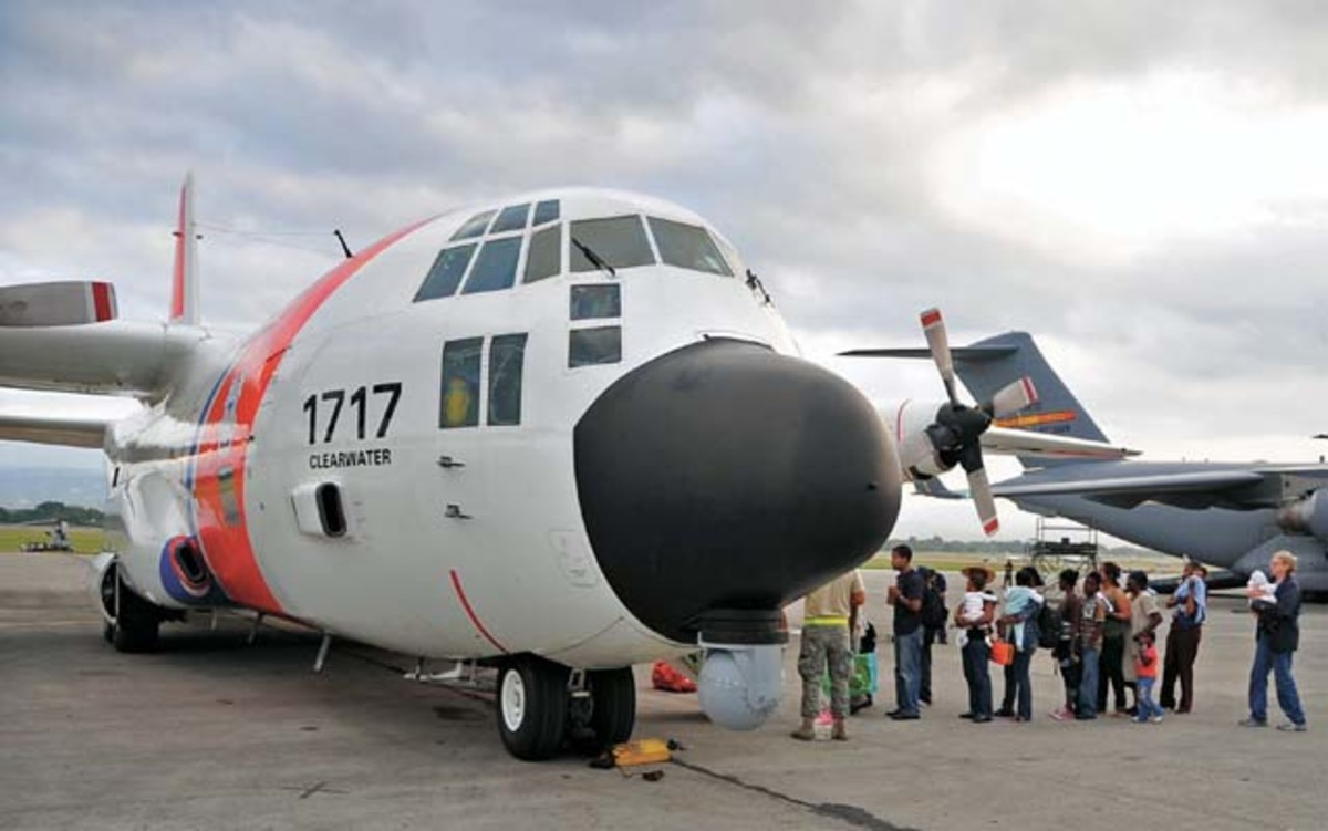A Coast Guard C-130 from Coast Guard Air Station Clearwater, Florida, takes on Haitian-American passengers prior to an air evacuation to Homestead.