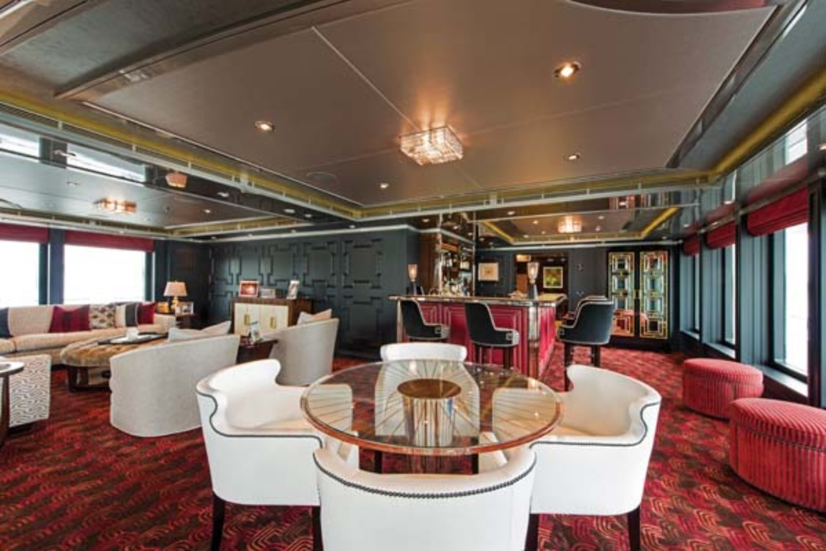 The rich colors and emphatic geometric patterns that anchor the skylounge bar's Art Deco theme are repeated in dramatically styled furnishings on the adjoining exterior aft deck.