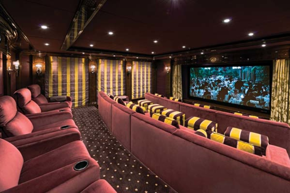 The main-deck cinema features advanced audio/visual technology.