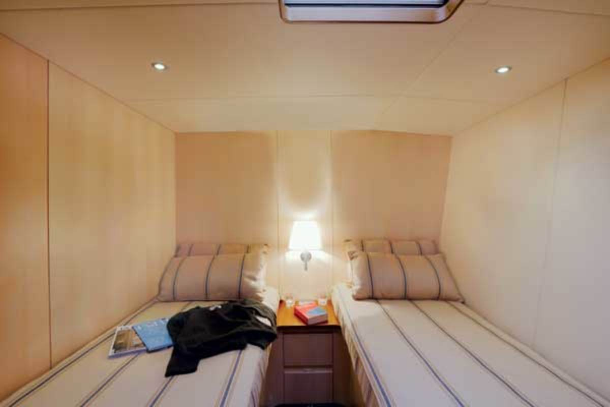 Six guests are carried in three cabins, two of which feature twin beds.