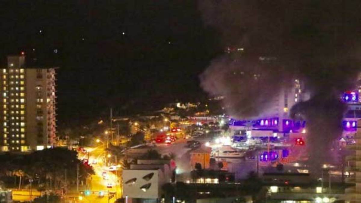 (Courtesy: Mark Deren)  View of the burning yachts at Bahia Mar from the 24th floor of the Jackson Tower Condominium building on South Birch Road.