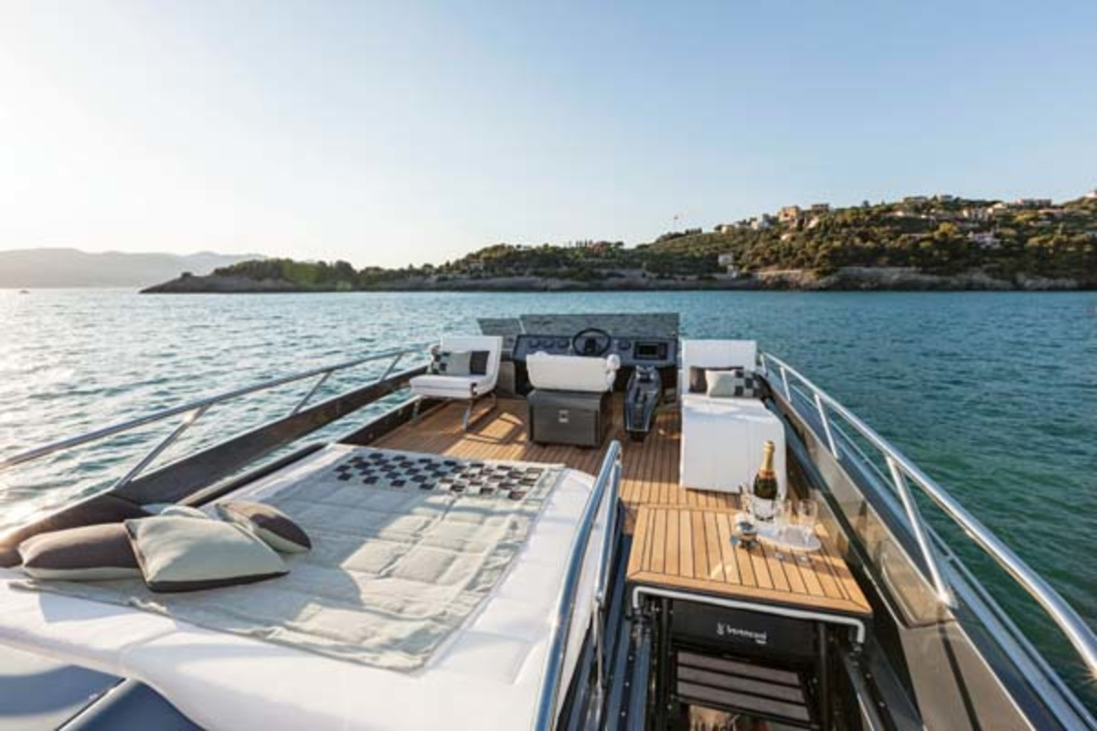 The 82's roomy flybridge with its sunbed, folding lounges and optional foldaway helm station