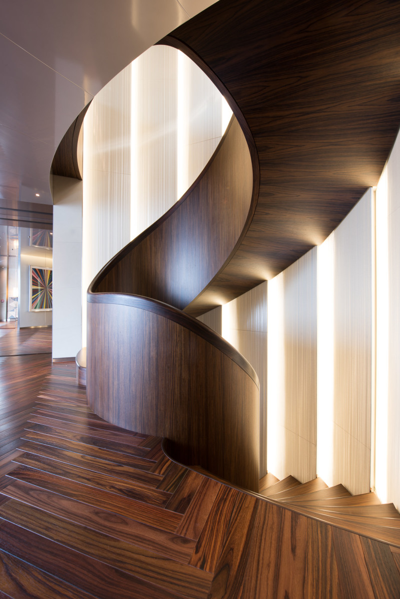 In addition to her sheer magnitude, exterior design, underwater lounge, sophisticated lighting scheme and hybrid propulsion technology, SAVANNAH is a standout for her imaginative interior layout and holistic design by Cristina Gherardi Benardeau and Marcello Bozzarelli of CG Design in Paris. Pictured here, the winding central staircase exemplifies the yacht's contrast of simplicity and complexity, and the artistic use of light found throughout.