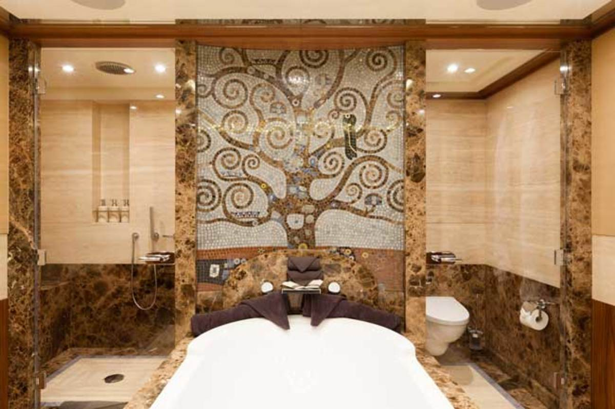 Any number of quirky features and fixtures lend real character to the yacht, including occasional tables and light fittings that seem to be assembled from twigs, fabrics imbued with the textures and patterns of stylized flowers and leaves, and even a head in the master suite whose central focus is a metaphorical hot spring emanating from a symbolic tree of life.