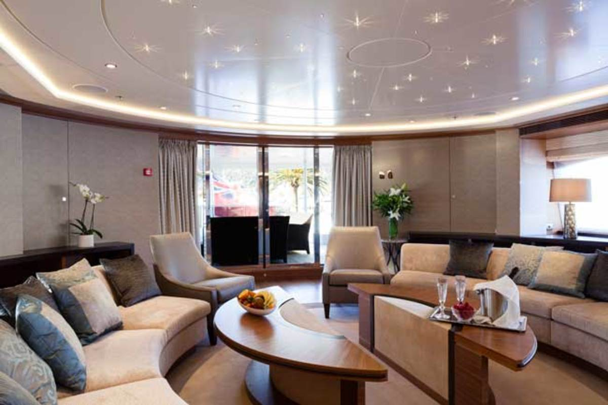 Two decks, two entertainment areas. The private salon upstairs, and (below) the main-deck salon, looking forward.