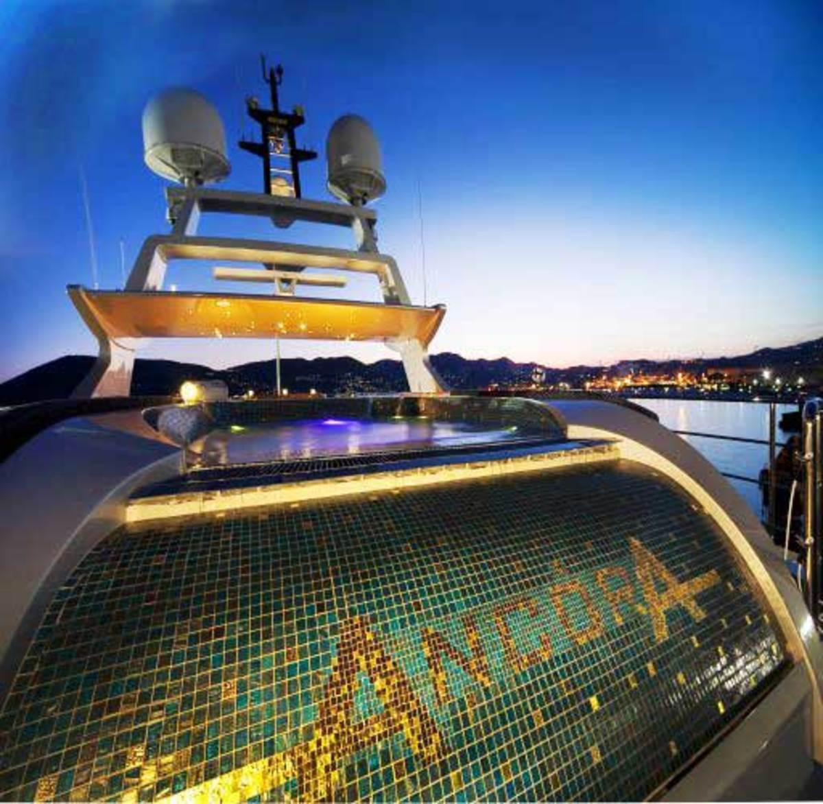 The aft sundeck of Ancora is equipped with a remarkable custom infinity pool lined with mosaic tiles.