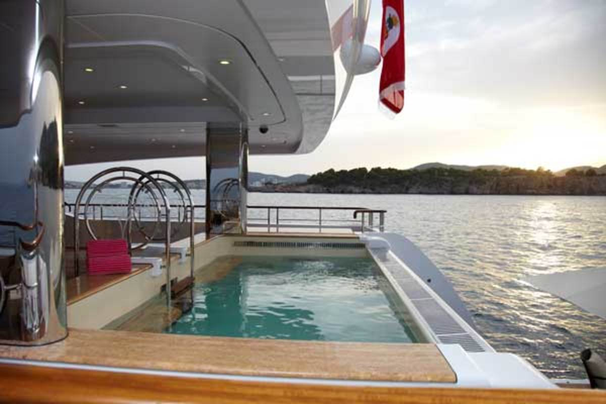 Sloshing water was an issue when it came to designing the pool aboard 223-foot (68-meter) Lady Christine, so Feadship devised a system to create a cascade effect with spray nozzles evenly distributed across the glass.