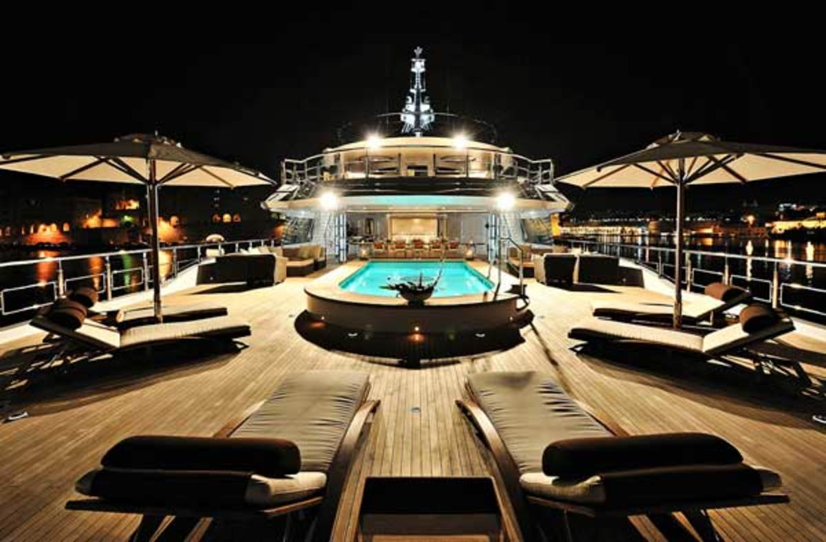 The swimming pool on Oceanco's Vibrant Curiosity was placed on the upper deck with skylights in the bottom, illuminating a lower deck corridor leading from the aft platform up to the main salon.