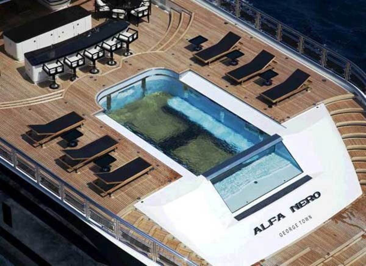 Complete with glass waterfall siding, Alfa Nero's infinity swimming pool can be hydraulically raised to provide a helipad that doubles as a dance floor.