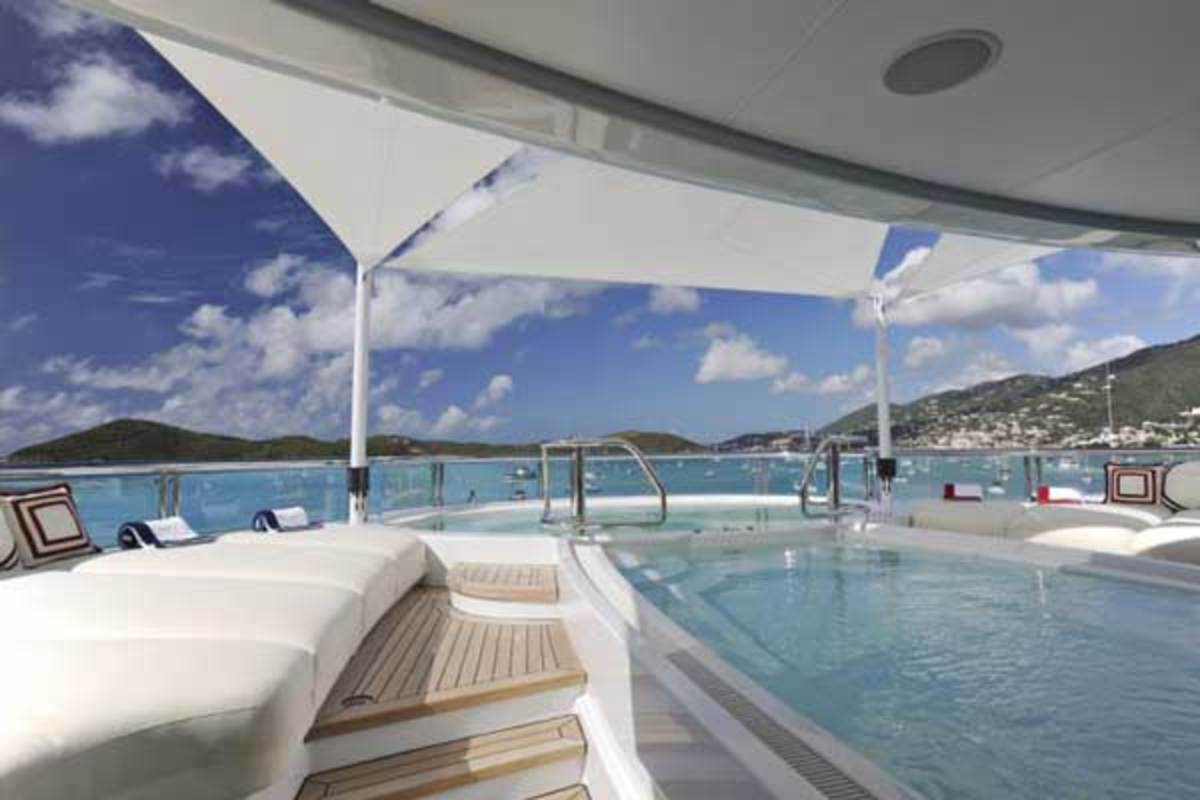 Superyacht TV's sundeck area features a large outside Jacuzzi pool with a capacity of 16 persons and a contra-flow swimming pool.
