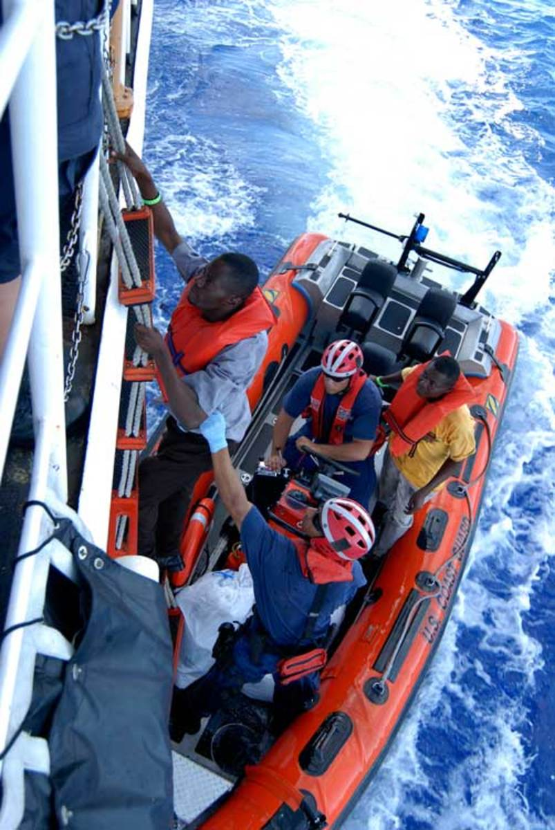 Haitian migrants are transferred to Coast Guard Cutter Resolute after being interdicted.
