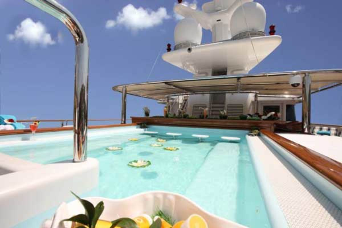 The sun deck of 228-foot Nomad features a Jacuzzi spa pool where you can swim up to the bar, with sunbathing mattresses on each side as well as a fantastic barbeque area.