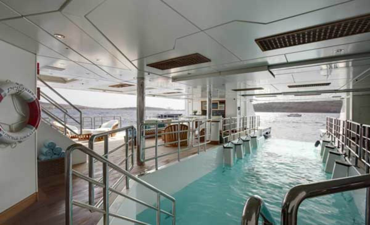 "The Beach Club on Pegasus V can be ""flooded"" when the tender is out, forming a 12-meter swimming pool with underwater lighting and steps."