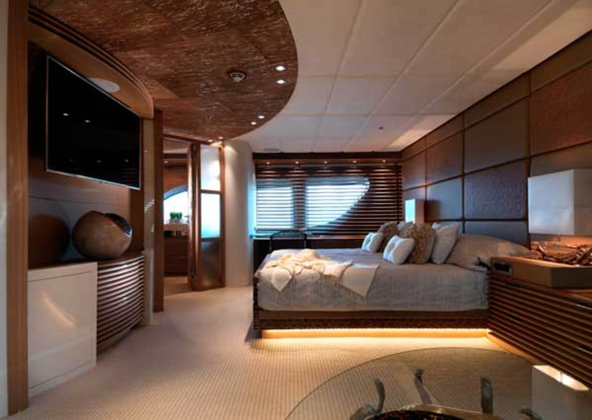 In the full-beam master stateroom, the bed is placed off-center to make room for a lounge area.
