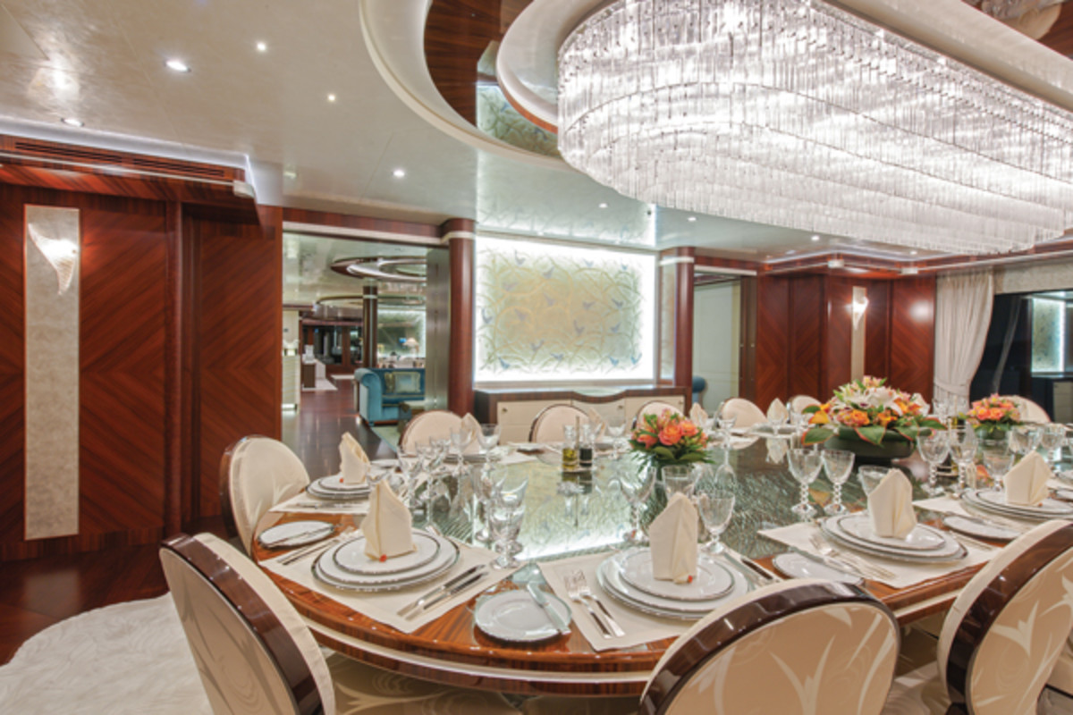 The Murano glass chandelier overhanging the main dining table on Lurssen's Quattroelle