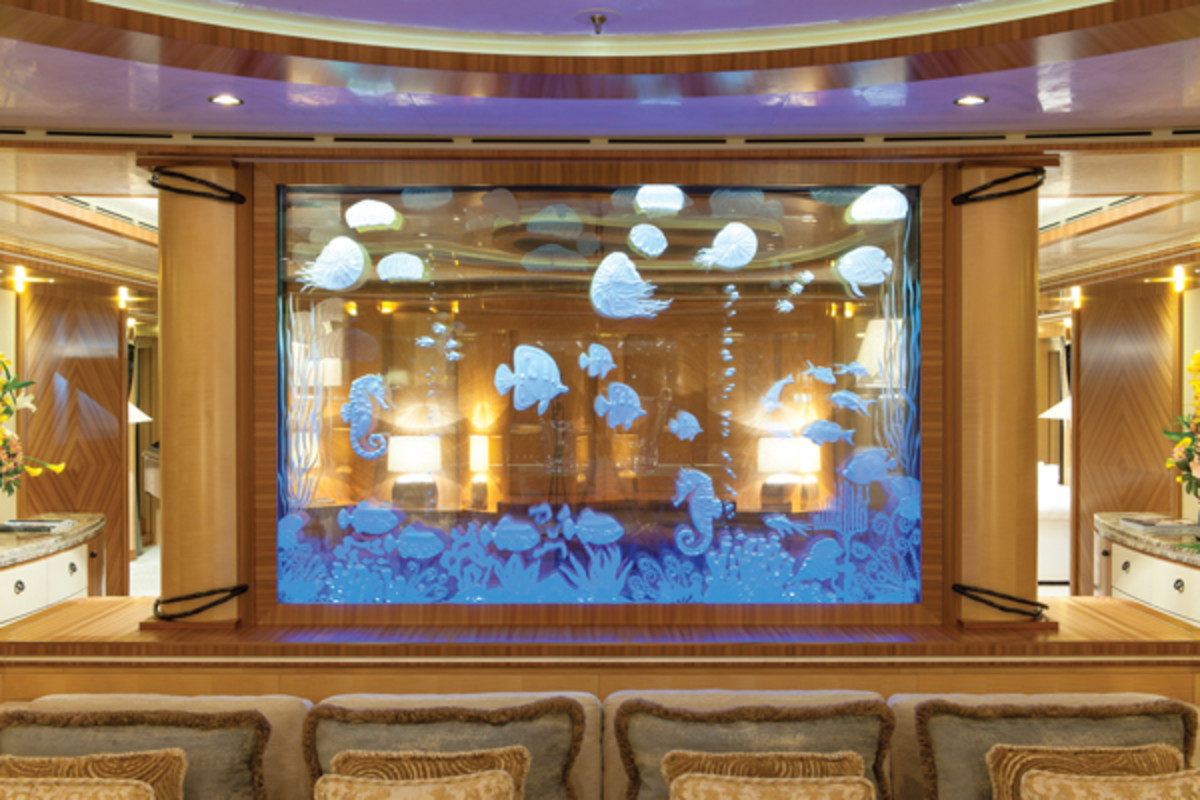 Illuminated art glass dividing the TV/lounge areas on the upper deck