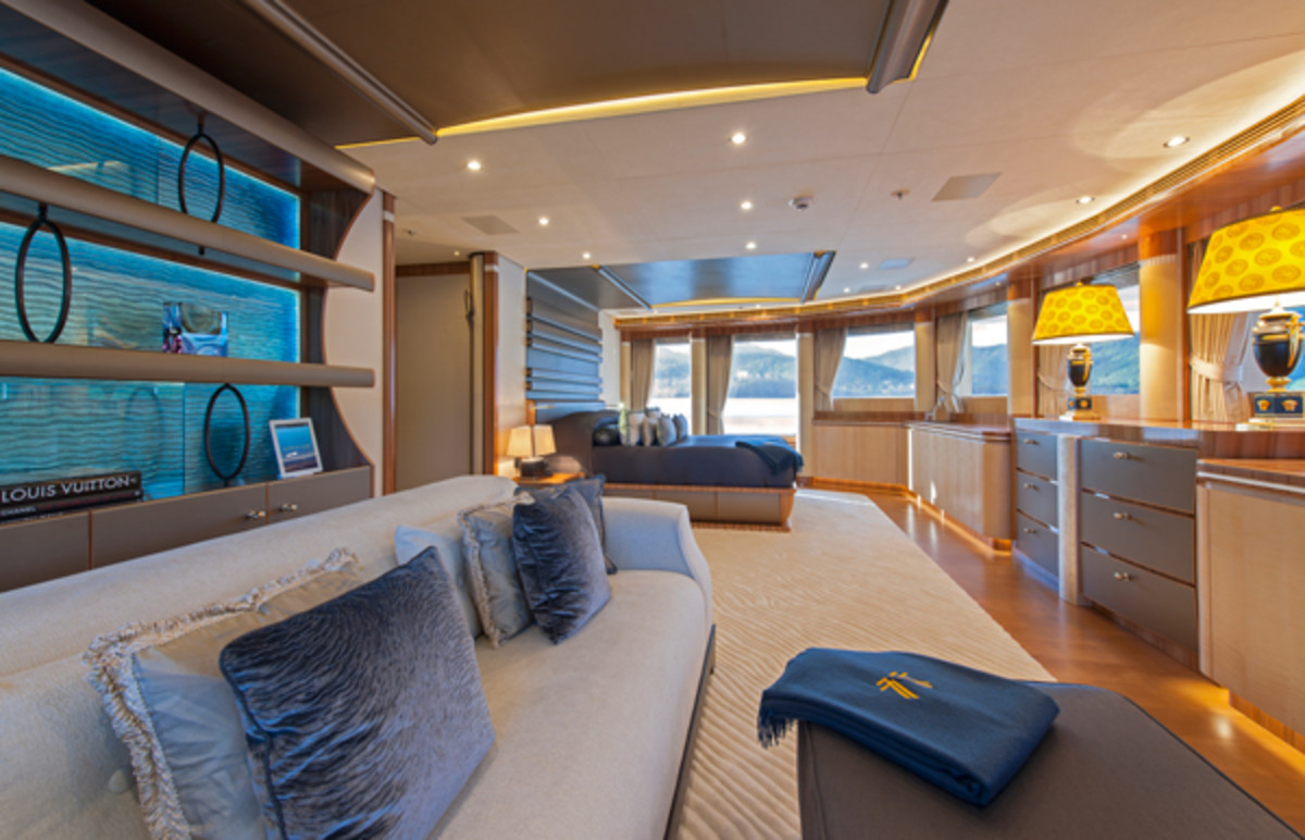 The owner's suite on the upper deck features a side-opening door to access the private terrace forward.