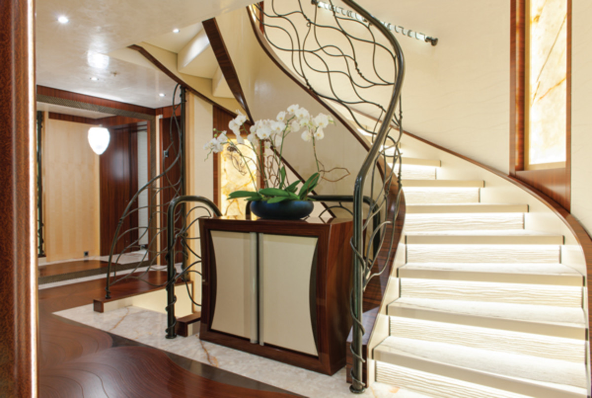 The flowing metalwork of the grand staircase on Lurssen's Quattroelle