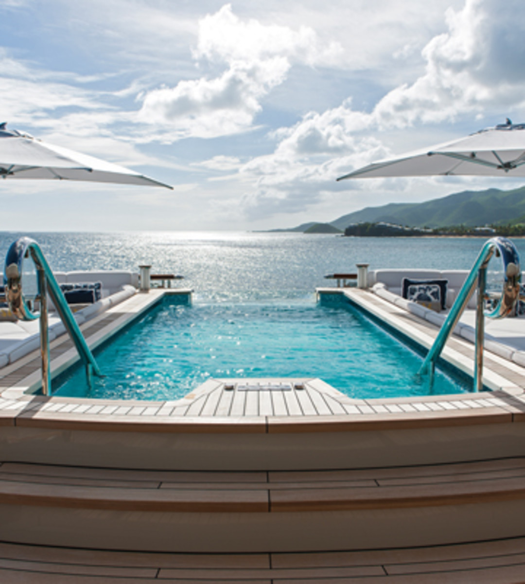 The spa pool with its infinity glass wall for uninterrupted sea views and surrounding sun beds on Lurssen's Quattroelle