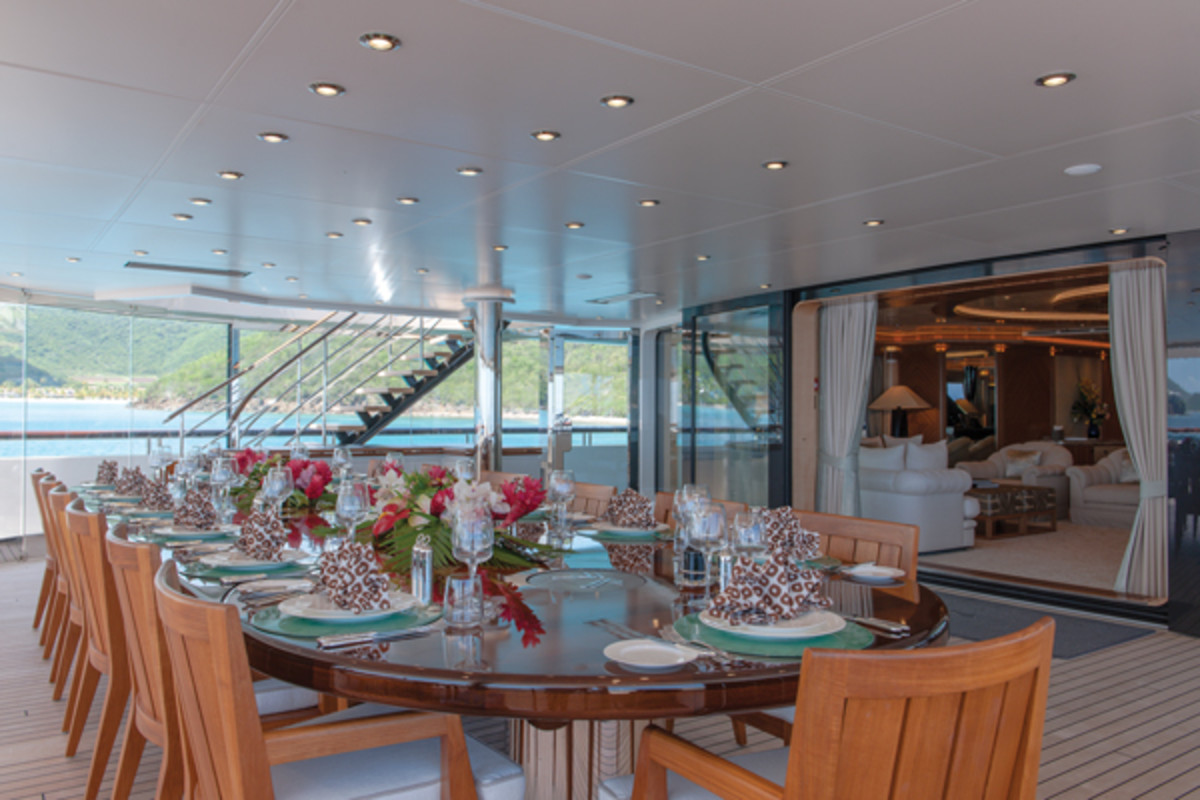 The 12-person dining table on the main aft deck on Lurssen's Quattroelle