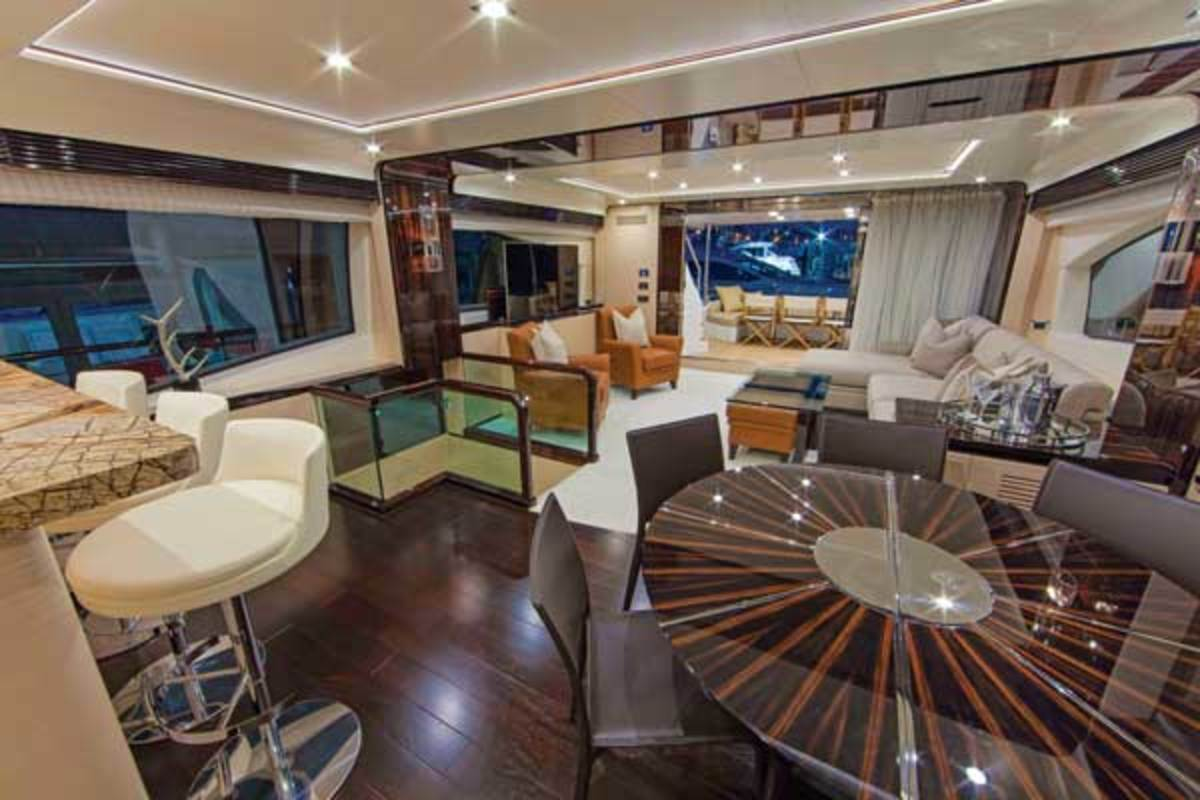The Azimut 84's contemporary living space with main-deck galley open to the salon flows seamlessly to the afterdeck.