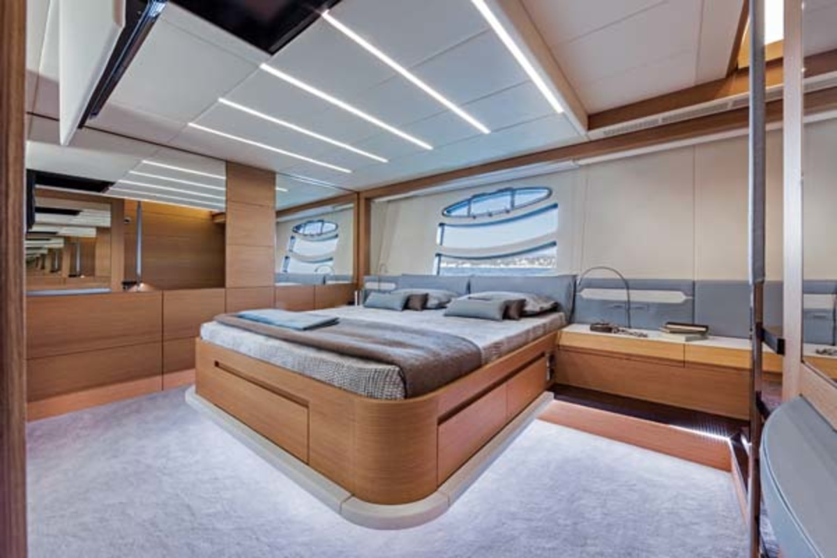 The master suite occupies the full beam, with big hull windows and excellent stowage volume. A television drops down from the deckhead.