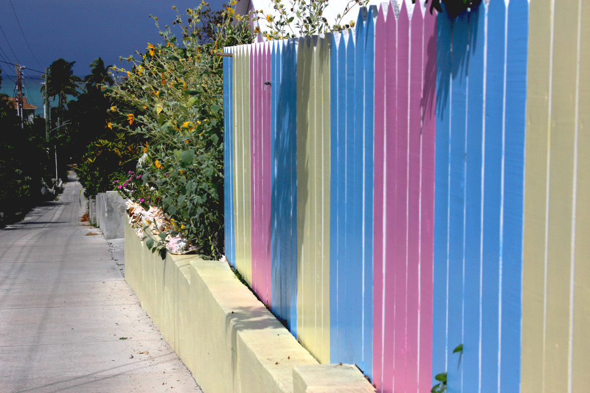 This brightly painted fence on Man-O-War Cay is the norm for scenery ashore.