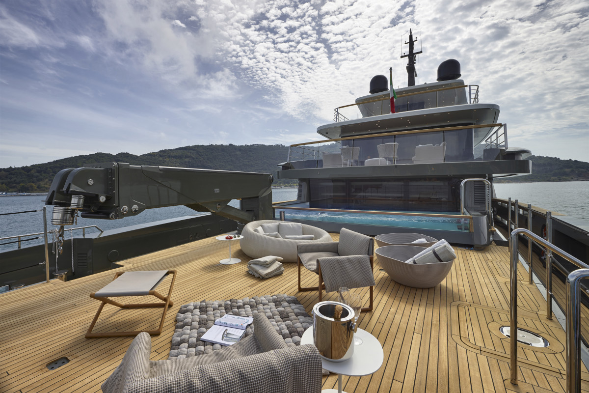 The aft deck is laid out for relaxation at anchor, while that four-ton crane reveals its alternate purpose.
