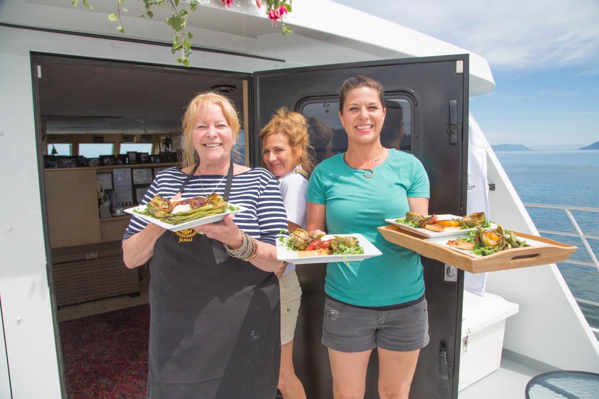 Chef Lenore Nolan-Ryan, Capt. Jennifer Hanna and first mate Joey Sternhagen serve lunch.